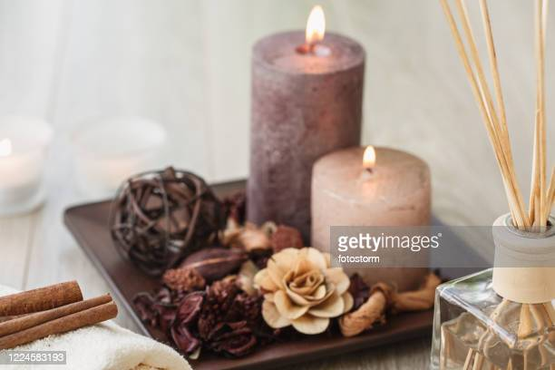 candles lit and aromas spreading to have a mindfulness meditation - candle stock pictures, royalty-free photos & images