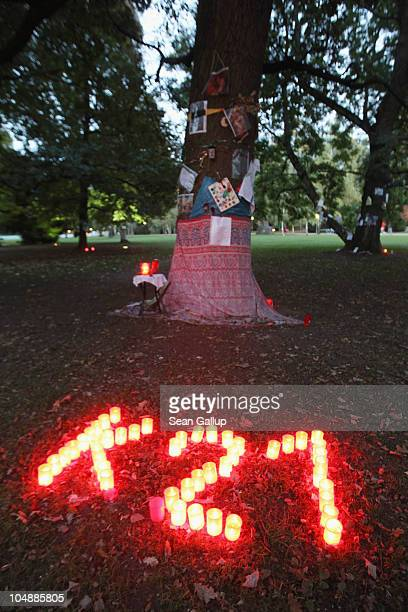 Candles lit by activists spell out 'K21' an abbreviation for 'Kopfbahnhof 21' or 'Terminal Station 21' in front of one of the nearly 300 trees slated...