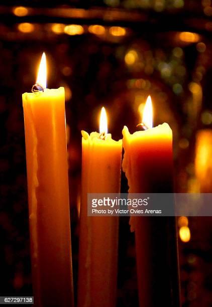 Candles lit in a church in Granada, Spain