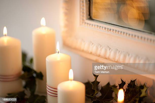 Candles lit on mantelpiece