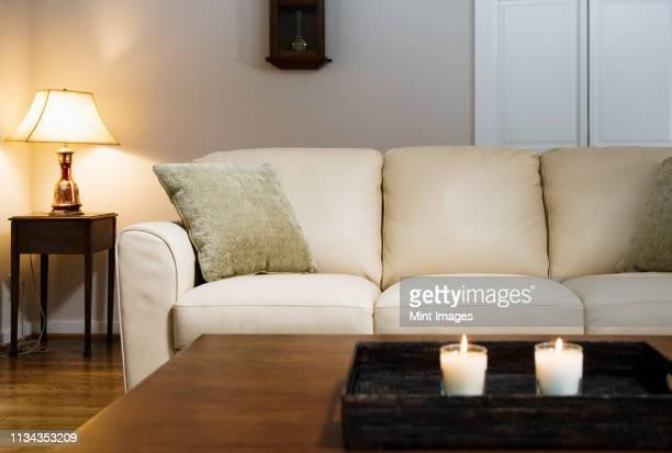 candles lit on tray in living room - tavolino foto e immagini stock