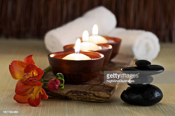 Candles, Massage Stones and Flower in Zen Spa