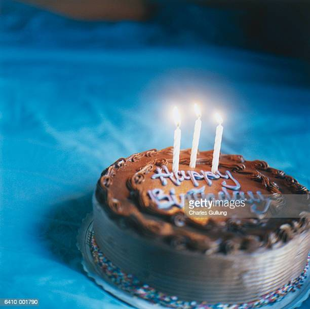 candles on birthday cake - image stock pictures, royalty-free photos & images