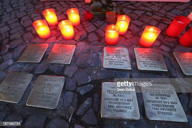 Candles placed at Stolpersteine by local people commemorating the 75th anniversary of the Kristallnacht pogroms cast light on the names of Jewish...