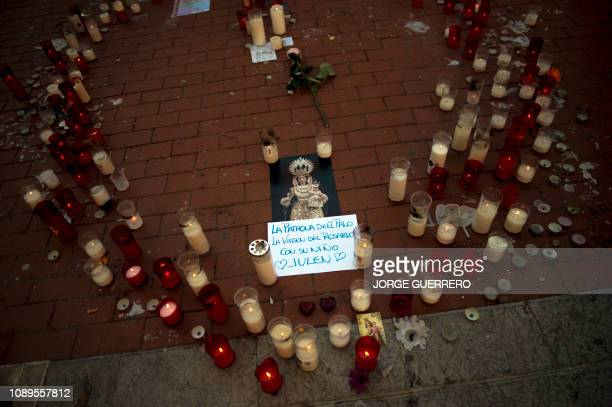 Candles remebering Julen the toddler rescued after falling down a well lie on the pavement in Malaga on January 26 2019 Spain grieved on today after...