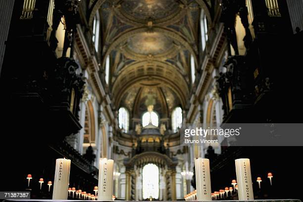 Candles representing the four London places hit by the 7/7 attacks in Saint Pauls Cathedral on July 7 2006 in London On July 7 2005 three Underground...