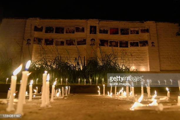 Candles seen lit up next to portraits and photographs of Danish Siddiqui during a candle light vigil in Srinagar. Reuters journalist Danish Siddiqui...