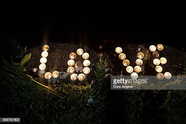 Candles sit on the edge of Lake Eola June 12 2016 in Orlando Florida The shooting at Pulse Nightclub which killed 50 people and injured 53 is the...
