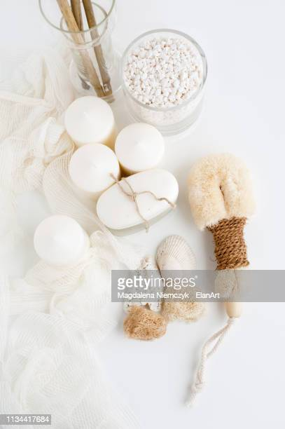 candles, soap and loofah - loofah stock photos and pictures