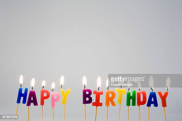 candles spelling ?happy birthday? - happy birthday stock pictures, royalty-free photos & images