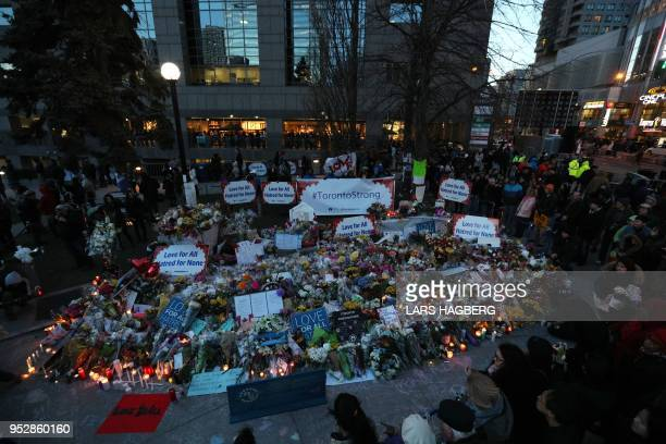 Candles surround a makeshift memorial in Mel Lastman Square in Toronto for the victims of the van attack before a vigil on April 29 2018