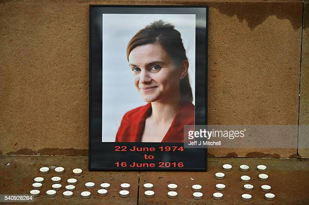 Candles surround a photo of Labour MP Jo Cox before a vigil in her memory in George Square on June 17 2016 in GLASGOW SCOTLAND The Labour MP for...