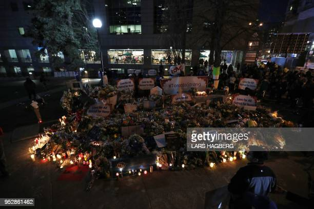 Candles surround the makeshift memorial at a makeshift memorial in Mel Lastman Square in Toronto for the victims of the van attack before a vigil on...