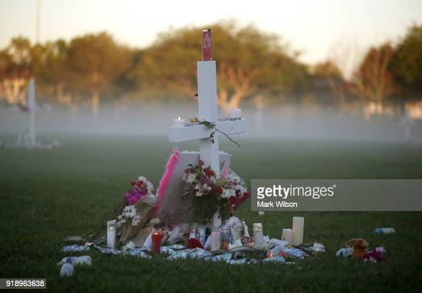 Candles that were placed on crosses still glow after last nights vigil for victims of the mass shooting at Marjory Stoneman Douglas High School at...