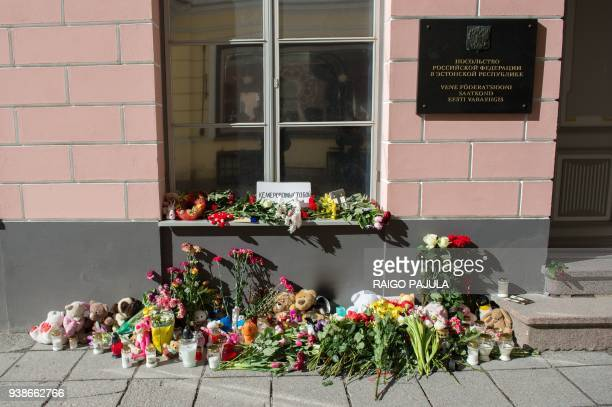 Candles toys and bounches of flowers lay in front of the Russian Embassy commemorating the fire tragedy victims of the Siberian coalmining city of...