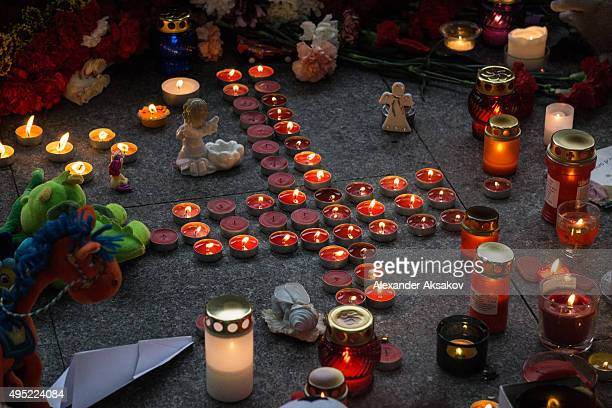 Candles toys and flowers are seen at the 'memorial' of the victims of the Airbus A321 crash at the Pulkovo Airport on November 1 2015 in St...