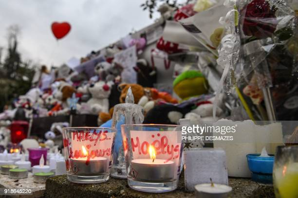 Candles toys and messages are displayed at a makeshift memorial in front of the town's community centre in tribute to late eightyearold Maelys de...
