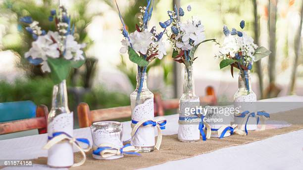 Candlestick and flower arrangement on table