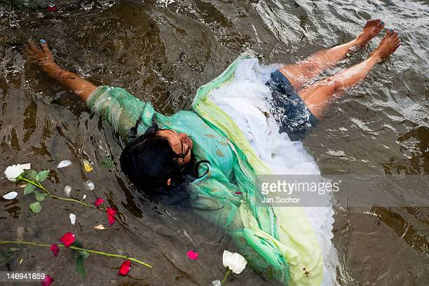 Candomblé believer becomes possessed in the water during the ritual celebration of Yemanjá the goddess of the sea on 2 February 2012 in Salvador...