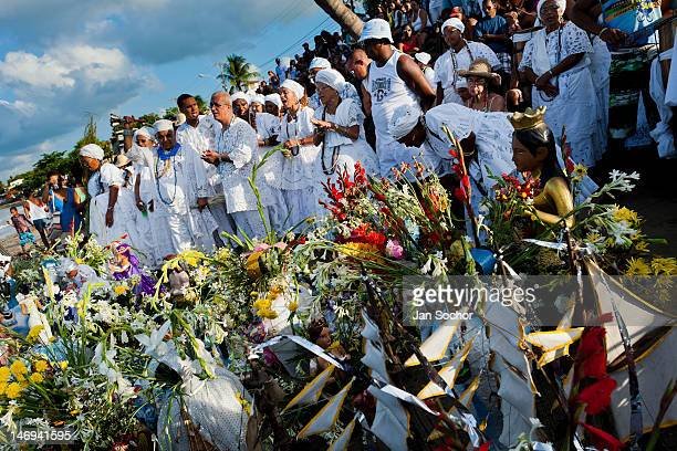 Candomblé devotees dance and sing during the ritual procession in honor to Yemanjá the goddess of the sea on 3 February 2012 in Amoreiras Bahia...