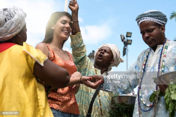 Candomble group blessing a woman