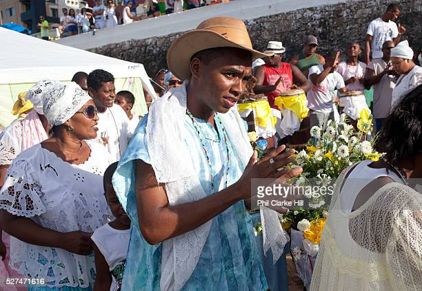 Candomble group in traditional white dress taking part in a public ceremony on the beach February 2nd is the feast of Yemanja a Candomble Umbanda...