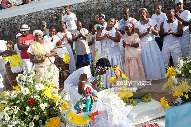 Candomble group in traditional white dress taking part in a public ceremony on the beach. February 2nd is the feast of Yemanja, a Candomble Umbanda...
