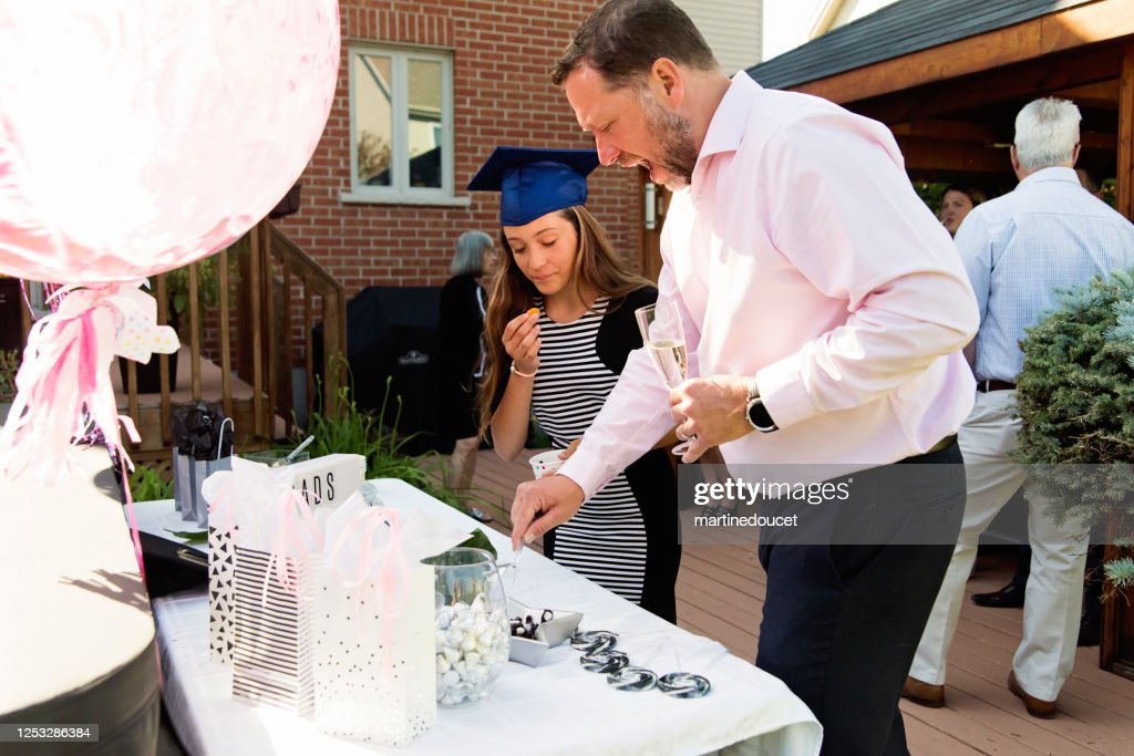 Candy bar for graduation from primary school party in backyard. : Stock Photo