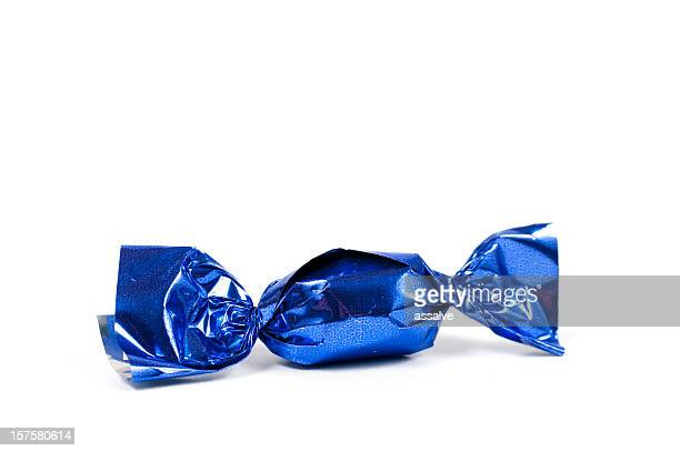 candy bonbon rolled into glittering blue aluminium foil