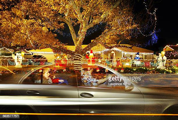 Candy Cane Lane type streets in Woodland Hills Cars cruising by a home on Lubao Ave with X'mas lawn decorations