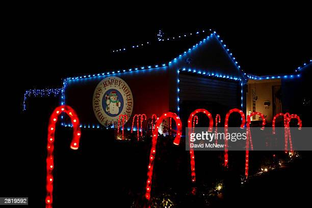 Candy Cane lights and a projected Happy Holidays wish adorn a house on December 17 2003 in Pasadena California Many of southern California's better...