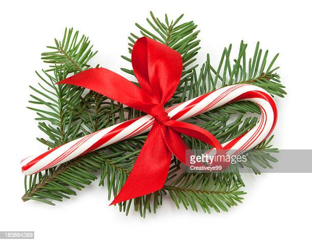 candy cane with red bow - candy cane stock pictures, royalty-free photos & images