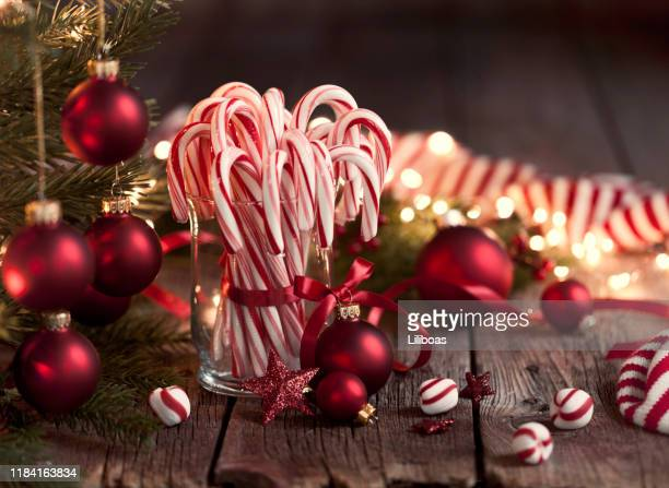 candy canes and bright christmas lights - candy cane stock pictures, royalty-free photos & images