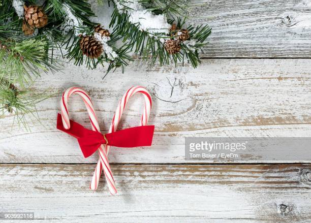 Candy Canes With Pine Needles On Table