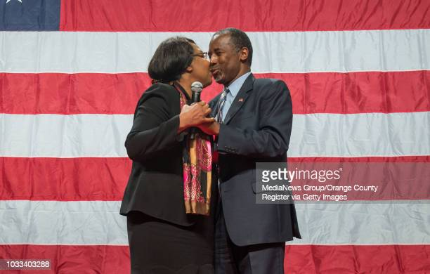 Candy Carson left comes out on stage to give her husband presidential candidate Ben Carson a kiss during a rally at the Anaheim Convention Center...