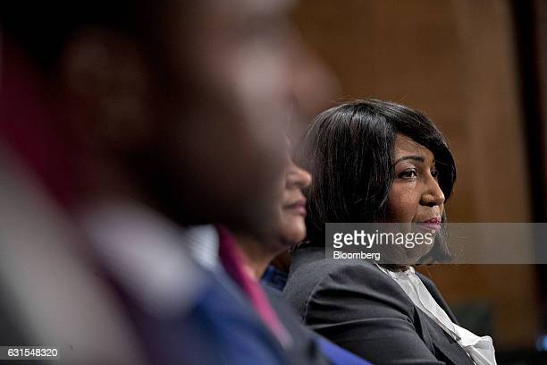Candy Carson listens as her husband Ben Carson secretary of US Housing and Urban Development nominee for Presidentelect Donald Trump testifies during...