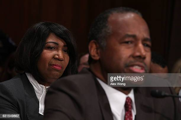 Candy Carson listens as her husband Secretary of Housing and Urban Developmentdesignate Ben Carson testifies during his confirmation hearing before...