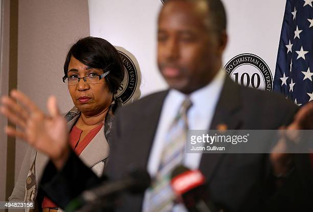 Candy Carson looks on as her husband republican presidential candidate Ben Carson speaks during a news conference before a campaign event at Colorado...