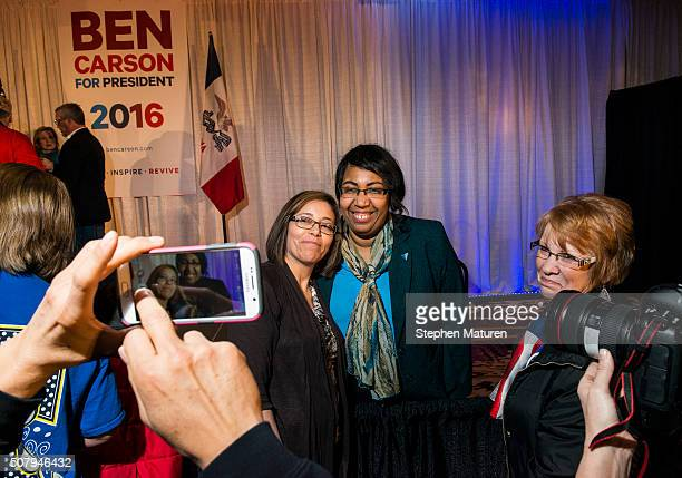 Candy Carson takes a photo with a supporter at Ben Carson's Iowa Caucus Night Party in the Marriott Hotel on February 1 2016 in West Des Moines Iowa...