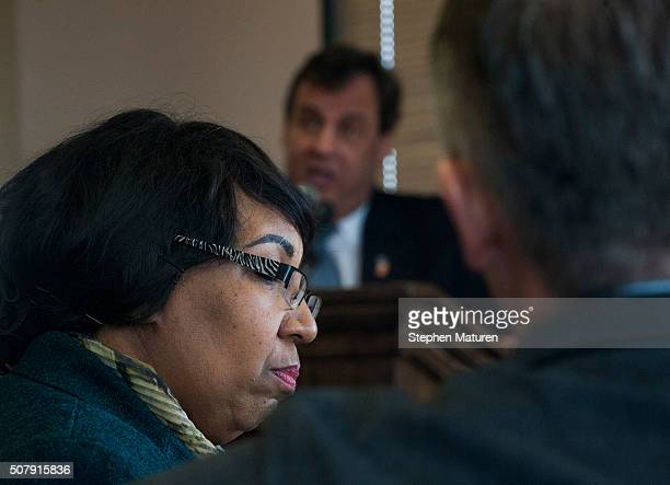 Candy Carson the wife of Republican presidential candidate Ben Carson listens to his competitor New Jersey Gov Chris Christie during a luncheon at...