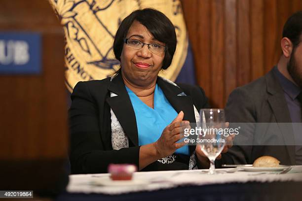 Candy Carson wife of Republican presidential candidate Dr Ben Carson listens to hime address the National Press Club Newsmakers Luncheon October 9...