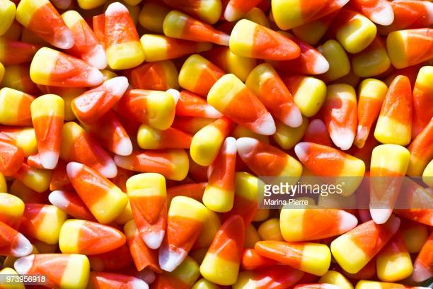 candy corn - candy corn stock photos and pictures