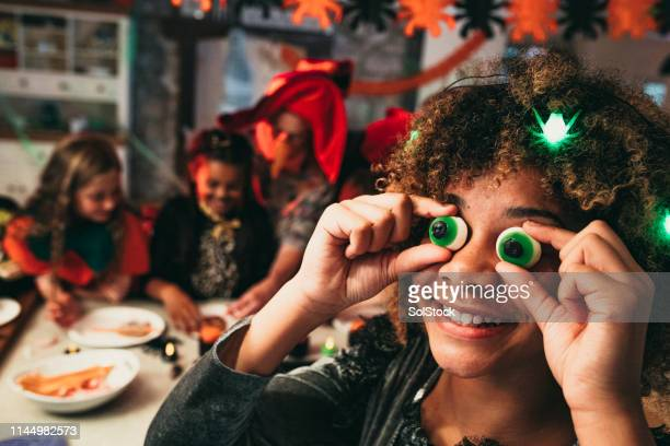 candy eyes - naughty halloween stock photos and pictures