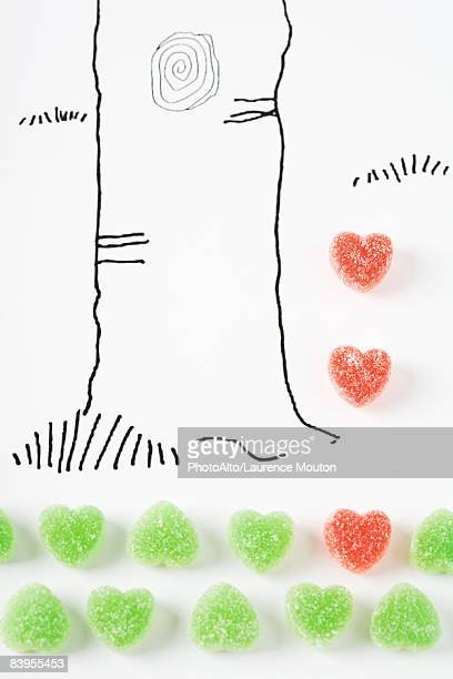 Candy hearts and drawing of tree trunk