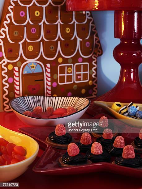 candy in bowls with a advent calendar in the background. - avvento foto e immagini stock
