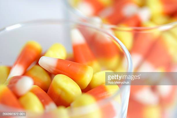 candy in jars, close-up - candy corn stock photos and pictures