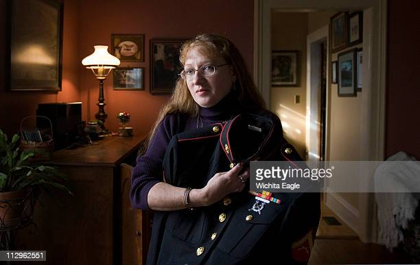 Candy Wasser holds the Marine Uniform of her son Christopher inside her home in Ottawa, Kansas. Christopher was killed in a explosion while on a foot...