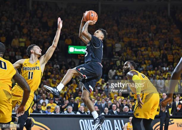 Cane Broome of the Cincinnati Bearcats scores a basket over Landry Shamet of the Wichita State Shockers during the second half on March 4 2018 at...