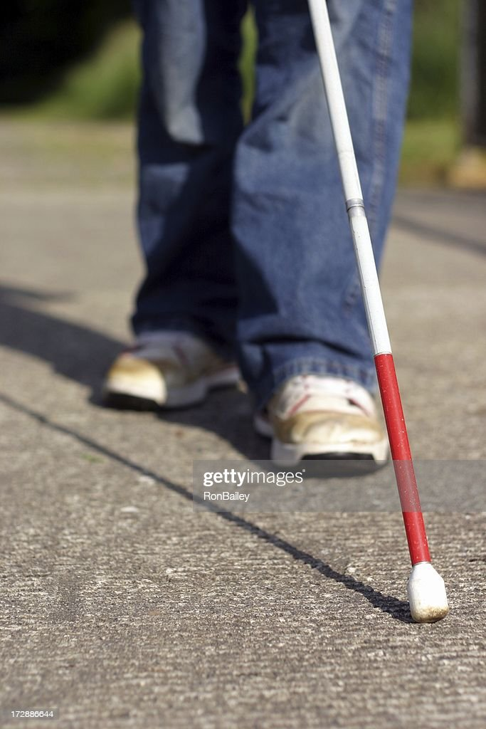 Cane Tip and Feet : Stock Photo