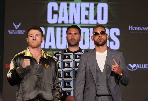 Canelo Alvarez and Billy Joe Saunders face off with Matchroom Promoter Eddie Hearn looking on during the press conference for Alvarez's WBC and WBA...